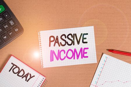 Conceptual hand writing showing Passive Income. Concept meaning the earnings derived from a rental property and others Cardboard notebook office study supplies chart paper Фото со стока