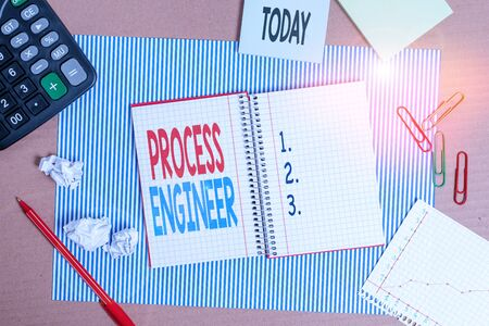 Writing note showing Process Engineer. Business concept for responsible for developing new industrial processes Striped paperboard notebook cardboard office study supplies chart paper