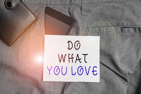 Conceptual hand writing showing Do What You Love. Concept meaning Make enjoyable things do activities with motivation Smartphone device inside trousers front pocket with wallet 스톡 콘텐츠