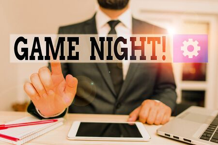 Word writing text Game Night. Business photo showcasing usually its called on adult play dates like poker with friends Male human wear formal clothes present presentation use hi tech smartphone Stock fotó