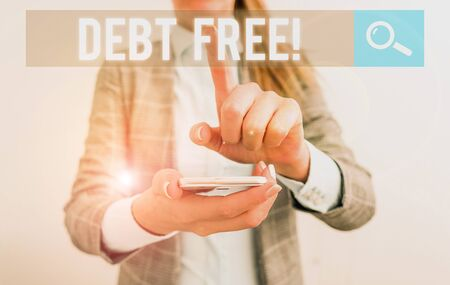 Conceptual hand writing showing Debt Free. Concept meaning does not owning any money to any individual or companies Business concept with mobile phone and business woman