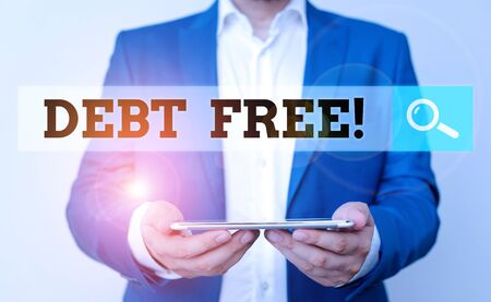 Word writing text Debt Free. Business photo showcasing does not owning any money to any individual or companies Man in the blue suite and white shirt holds mobile phone in the hand