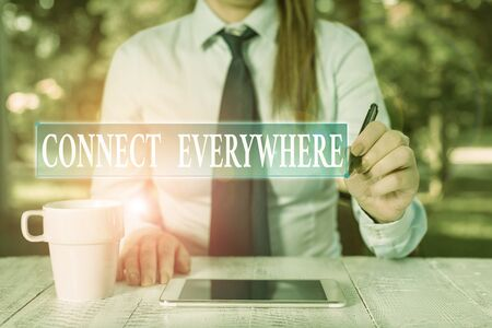 Conceptual hand writing showing Connect Everywhere. Concept meaning channel of communication available anywhere and anytime Female business person sitting and holding mobile phone