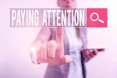 Text sign showing Paying Attention. Business photo showcasing watch or consider something or someone very carefully Digital business concept with business woman