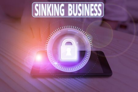 Text sign showing Sinking Business. Business photo showcasing the company or other organization that is failing Stok Fotoğraf