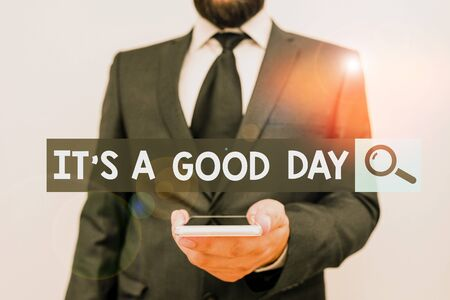 Writing note showing It s is A Good Day. Business concept for Happy time great vibes perfect to enjoy life beautiful Male human wear formal work suit hold smartphone using hand