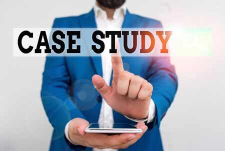 Text sign showing Case Study. Business photo text analysis and a specific research design for examining a problem Businessman in the blue suite with lap top pointing with finger