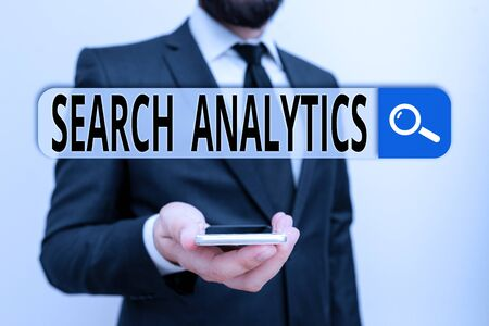 Writing note showing Search Analytics. Business concept for investigate particular interactions among Web searchers Male human wear formal work suit hold smartphone using hand