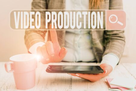 Handwriting text Video Production. Conceptual photo process of converting an idea into a video Filmaking Business woman sitting with mobile phone and cup of coffee on the table