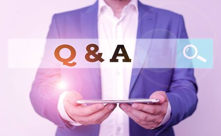 Word writing text Q And A. Business photo showcasing defined as questions being asked and answers Man in the blue suite and white shirt holds mobile phone in the hand