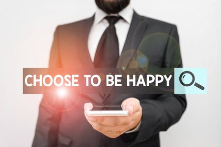 Writing note showing Choose To Be Happy. Business concept for Decide being in a good mood smiley cheerful glad enjoy Male human wear formal work suit hold smartphone using hand