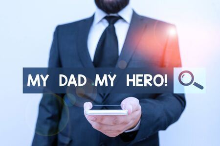 Writing note showing My Dad My Hero. Business concept for Admiration for your father love feelings emotions compliment Male human wear formal work suit hold smartphone using hand