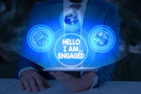 Handwriting text Hello I Am... Engaged. Conceptual photo He gave the ring We are going to get married Wedding