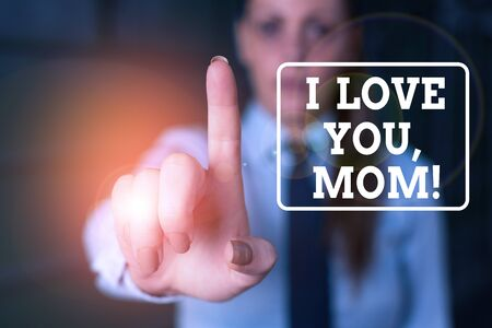 Conceptual hand writing showing I Love You, Mom. Concept meaning Loving message emotional feelings affection warm declaration Woman in the background pointing with finger in empty space