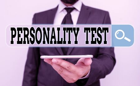 Conceptual hand writing showing Personality Test. Concept meaning A method of assessing huanalysis demonstratingality constructs Male human wear formal work suit hold smartphone using hand Фото со стока
