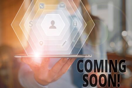 Text sign showing Coming Soon. Business photo text event or action that will happen after really short time Stock Photo