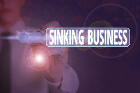 Writing note showing Sinking Business. Business concept for the company or other organization that is failing