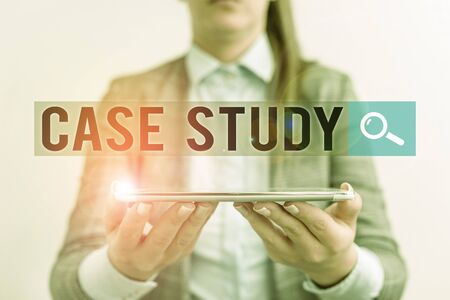 Handwriting text Case Study. Conceptual photo analysis and a specific research design for examining a problem Business concept with mobile phone and business woman