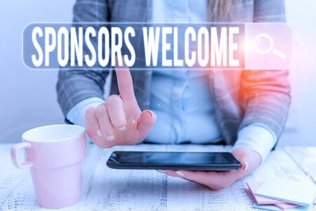 Handwriting text Sponsors Welcome. Conceptual photo greet advertiser that supports a business or individual Business woman sitting with mobile phone and cup of coffee on the table
