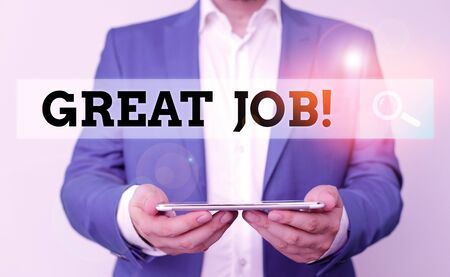 Word writing text Great Job. Business photo showcasing used praising someone for something they have done very well Man in the blue suite and white shirt holds mobile phone in the hand Banco de Imagens