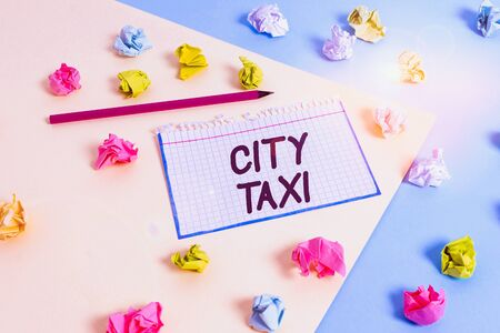 Word writing text City Taxi. Business photo showcasing type of vehicle for hire with a driver often for a nonshared ride Colored crumpled papers empty reminder blue yellow background clothespin