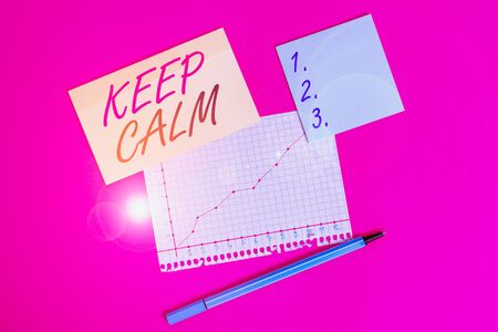 Writing note showing Keep Calm. Business concept for not get emotionally invested in situations you cannot control over Stationary and note paper math sheet with diagram picture on the table Stock Photo