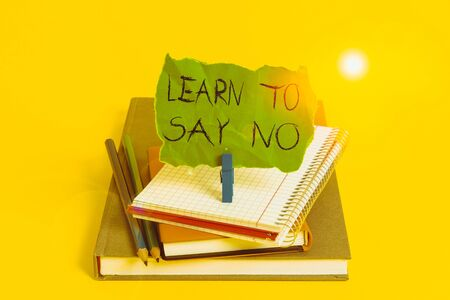 Text sign showing Learn To Say No. Business photo showcasing dont hesitate tell that you dont or want doing something Book pencil rectangle shaped reminder notebook clothespin office supplies