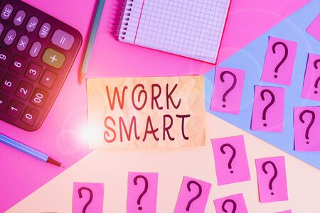 Writing note showing Work Smart. Business concept for figuring out in order to reach goals in the most efficient way Mathematics stuff and writing equipment above pastel colours background