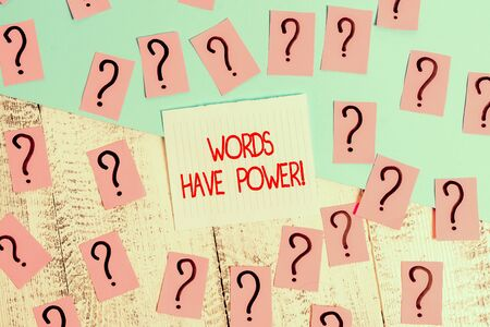 Word writing text Words Have Power. Business photo showcasing as they has ability to help heal hurt or harm someone Scribbled and crumbling papers with thick cardboard above wooden table