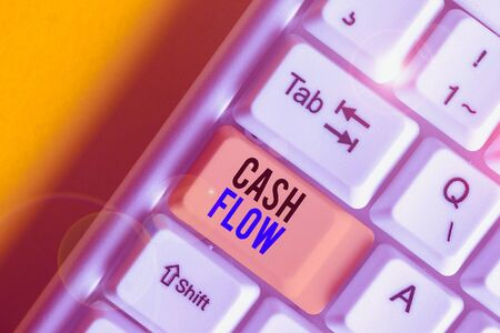 Word writing text Cash Flow. Business photo showcasing Movement of the money in and out affecting the liquidity White pc keyboard with empty note paper above white background key copy space