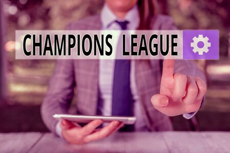 Conceptual hand writing showing Champions League. Concept meaning Yearly football competition from each country in Europe Female business person sitting by table holding mobile phone