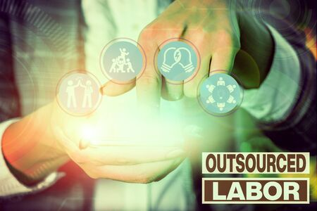 Writing note showing Outsourced Labor. Business concept for jobs handled or getting done by external workforce