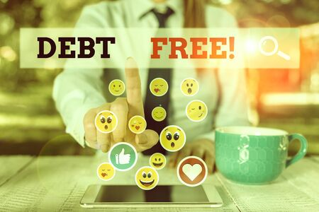 Writing note showing Debt Free. Business concept for does not owning any money to any individual or companies
