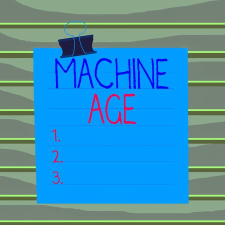 Conceptual hand writing showing Machine Age. Concept meaning period of development of new technology and industrial processes Paper lines binder clip suare notebook color background
