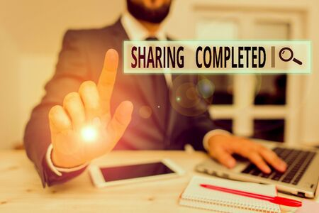 Word writing text Sharing Completed. Business photo showcasing to bring to an end and especially into a perfected state Male human wear formal clothes present presentation use hi tech smartphone