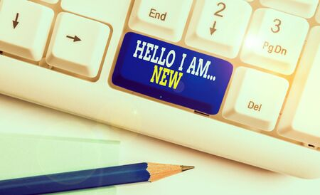 Writing note showing Hello I Am New. Business concept for Introduce yourself Meeting Greeting Work Fresh worker School White pc keyboard with note paper above the white background Stock Photo