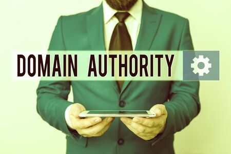 Text sign showing Domain Authority. Business photo text calculated metric for how well a domain is likely to rank Businessman in blue suite with a tie holds lap top in hands