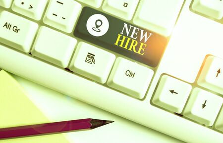 Word writing text New Hire. Business photo showcasing someone who has not previously been employed by the organization White pc keyboard with empty note paper above white background key copy space