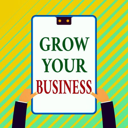Writing note showing Grow Your Business. Business concept for Achieve higher profit Provide better return of investment White rectangle clipboard with blue frame has two holes holds by hands