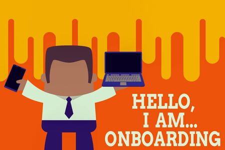 Text sign showing Hello I Am Onboarding. Business photo showcasing telling demonstrating that you are on ship or plane Standing professional man tie holding left open laptop right mobile phone Stock Photo