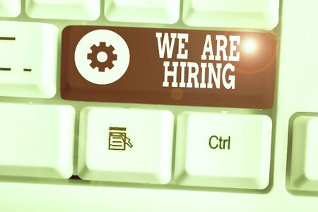 Text sign showing We Are Hiring. Business photo showcasing Workforce Wanted HR recruiting new hire employee Vacancy Stock Photo