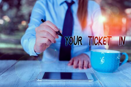 Word writing text Your Ticket In. Business photo showcasing piece of paper that prove you paid for service or show Business woman sitting by the table with cup of coffee and mobile phone