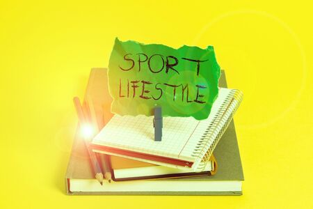 Text sign showing Sport Lifestyle. Business photo showcasing athletic lifestyle to get healthy and full of happiness Book pencil rectangle shaped reminder notebook clothespin office supplies
