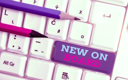 Conceptual hand writing showing New On Board. Concept meaning Welcome to the team Adaptation Collaboration Someone hired White pc keyboard with note paper above the white background Stock Photo
