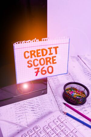 Writing note showing Credit Score 760. Business concept for numerical expression based on level analysis of demonstrating Note paper taped to black computer screen near keyboard and stationary