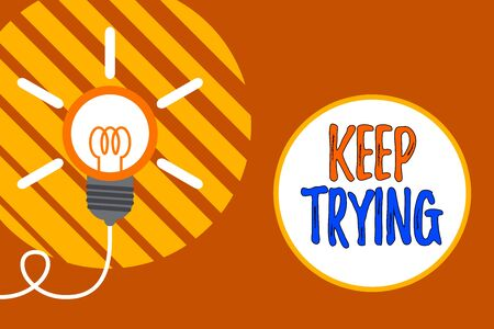 Text sign showing Keep Trying. Business photo showcasing continue to do something or to do something again and again Big idea light bulb. Successful turning idea invention innovation. Startup