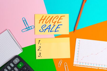 Conceptual hand writing showing Huge Sale. Concept meaning putting products on high discount Great price Black Friday Office appliance square desk study supplies paper sticker