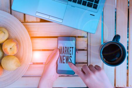 Handwriting text writing Market News. Conceptual photo Commercial Notice Trade Report Market Update Corporate Insight woman computer smartphone drink mug office supplies technological devices