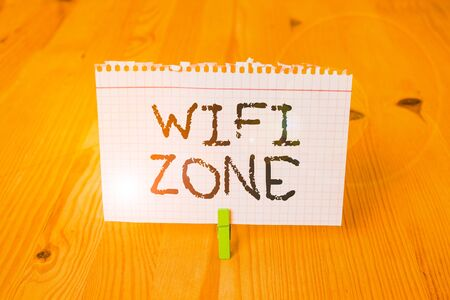 Word writing text Wifi Zone. Business photo showcasing provide wireless highspeed Internet and network connections Empty reminder wooden floor background green clothespin groove slot office