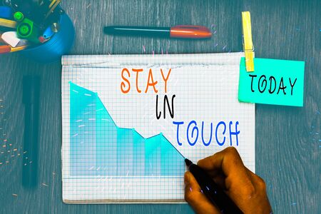 Writing note showing Stay In Touch. Business concept for Keep Connected thru Phone Letters Visit Email Social Media